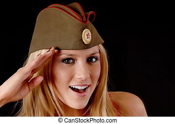 Isolated lovely and sexy young blond girl wearing a soviet army cap