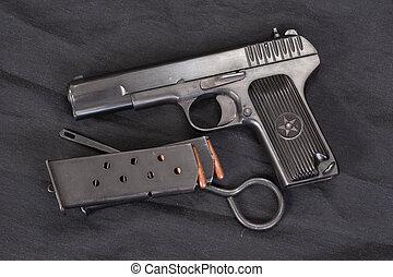 Soviet handgun on black background