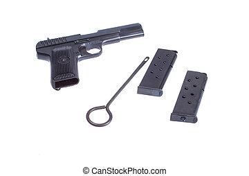 Soviet handgun TT (Tula, Tokarev) and accessories isolated...