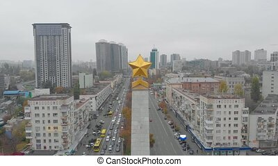 Soviet monument star aerial drone view push out backward camera movement Victory Square Kiev Ukraine