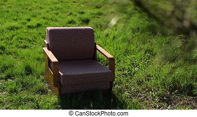 Soviet old armchair on green grass outdoor. - Soviet old...