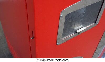 Soviet vintage red vending soda machine.