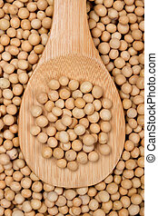Close-up image of raw soy bean on wooden spoon