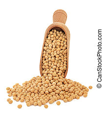 Soya beans in a wooden scoop over white background.