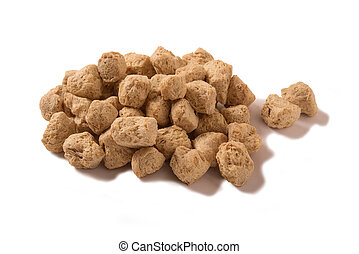 Soya chunks isolated on white background.
