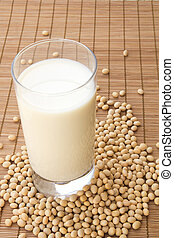 Soya milk - Glass of soya milk surrounded by soya beans