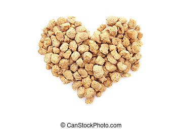 Soya protein chunks in a heart shape, isolated on a white...