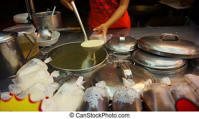 soybean milk boiling selling in Asian stall market