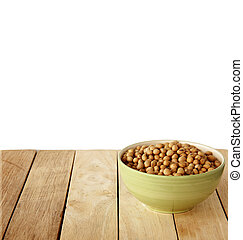 soybeens are on wooden background.