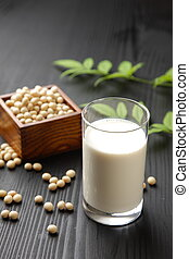 soymilk - studio shot of a glass of soymilk and soybeans