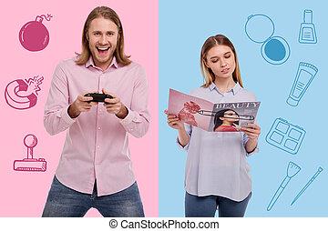 spänd, man, spelande video vilt, och, a, stillhet, kvinna läsning, a, tidskrift