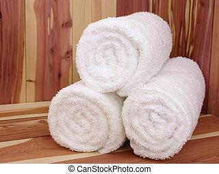 Spa 04 - White towels on a cedar sauna bench.