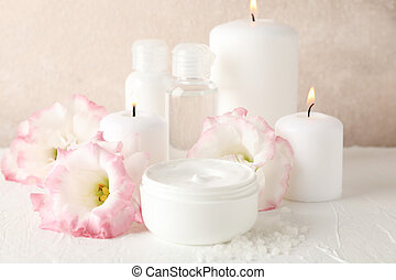 Spa accessories and beautiful flowers on white background, close up