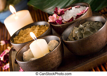 Spa accessories: candles, scented stones, mud, body scrub, bath salt and rose petals