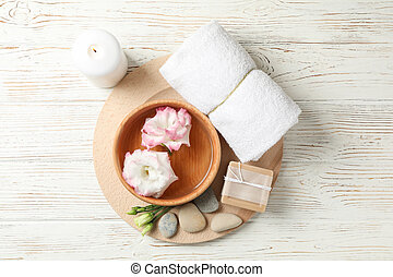 Spa accessories on white wooden background, top view