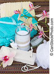 spa accessories with blue towels