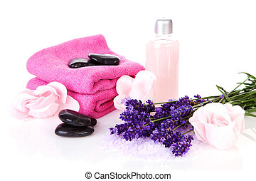 Spa accessory with pink towels, black stapping stones and lavender flowers