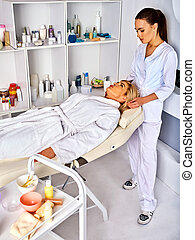 Spa and massage deals. Facial treatment for forty five year...