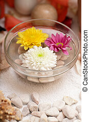 Spa and wellness details - Preparing an aromatherapy session, flowers, water and oils.