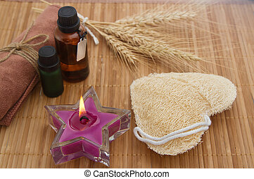 Spa and wellness setting with candles and essencial oil for scrub and massage