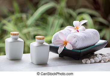 Spa and wellness setting with natural soap, stones and towel...