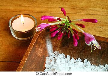 Spa still life. Honeysuckle flower, candle and seasalt