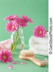 spa aromatherapy with gerbera flowers towel brush