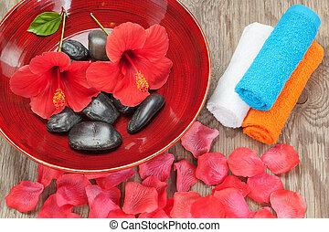 Spa arrangement of flower petals. On a wooden tecture.