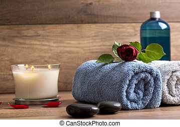 Spa arrangement, with two rolled towels, lit candle, black...