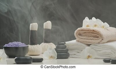 Spa background. Towel, candles, flowers, stones and herbal ...