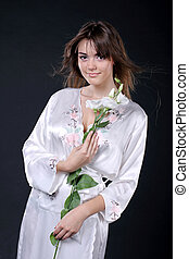 Spa, beautiful woman  in oriental robe with flowers