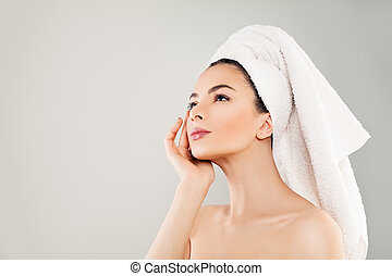 Spa Beauty. Cute Young Woman with Healthy Skin Looking Up