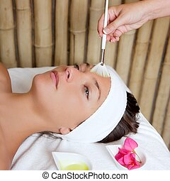 spa beauty facial treatment oil brush and flowers