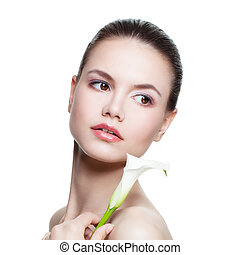 Spa Beauty Portrait of Perfect Woman. Beautiful Face, Fresh Skin and Lily Flower Isolated