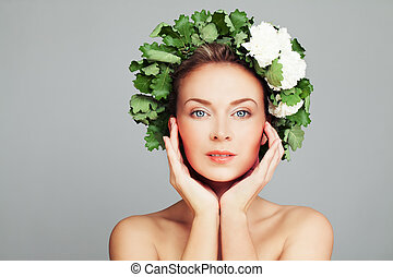 Spa Beauty Portrait of Perfect Woman with Pretty Face and Wreath of Green Leaves