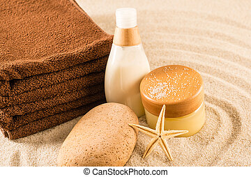 Spa beauty treatment products on sand natural body care