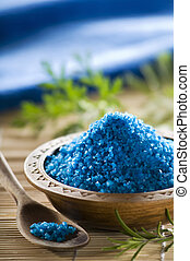 spa - blue aromatic salt in a wooden bowl close up shoot