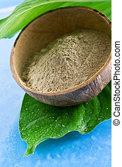 Green clay in a bowl. Spa and beauty concept.