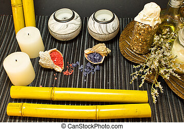 Still life of tools for massages, candles and bath salts in shells