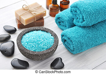 Spa composition with blue sea salt and massaging stones on...