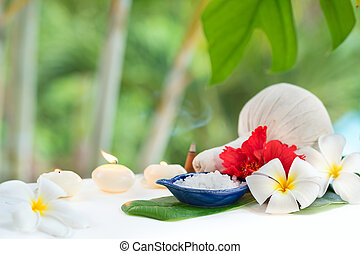 Spa concept herb salt plumeria flowers tropic leaf