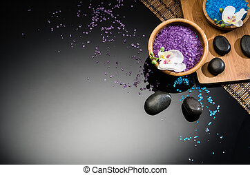 Spa concept on black background. Top view with copy space