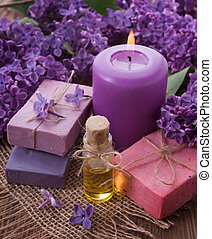 Spa concept. Soap, oil, candle, lilac