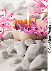 Spa concept - White stones,candles and flowers