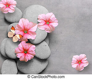 Spa concept with flower, butterfly and zen stones