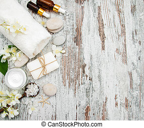 Spa concept with jasmine flowers on a old wooden background