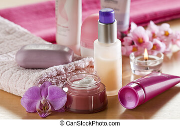 spa - Cream, soap towels and orchid close up