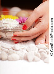 Spa details - bowl with flowers, pebbles