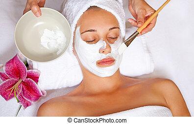 spa face mask - woman at spa having relaxing face mask