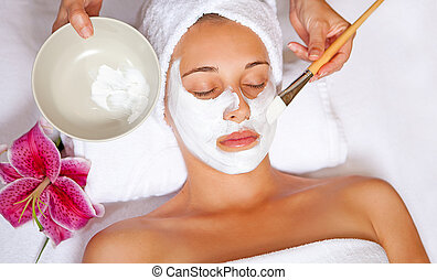 spa face mask - woman at spa having relaxing face mask